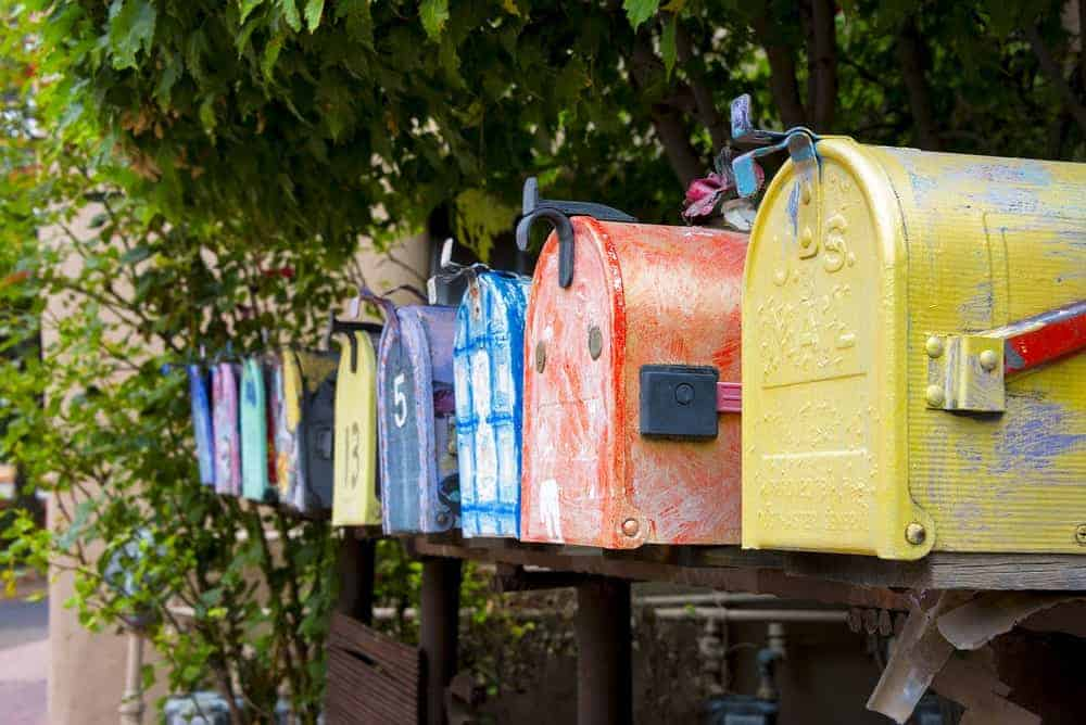 Colorful vintage mailboxes on the roadside.