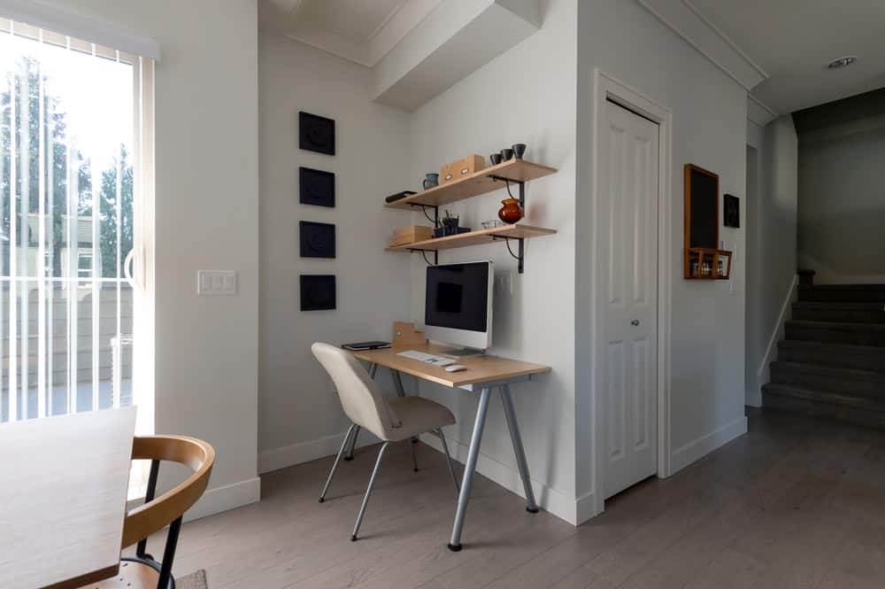 If you have no dedicated room available, look for an unused corner where you can put a small desk (we have this IKEA desk as well). You really don't need much space and as you can see this work area looks good, is very inexpensive and serves perfectly well for a home office.