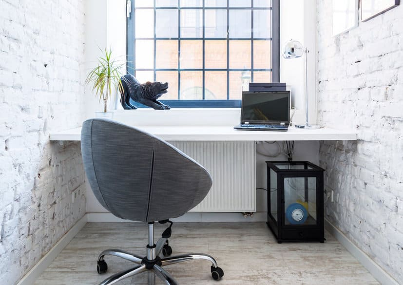 Small white home office with window