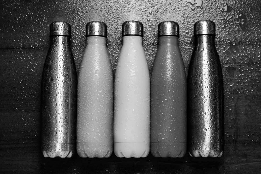 Wet stainless steel thermos bottles.