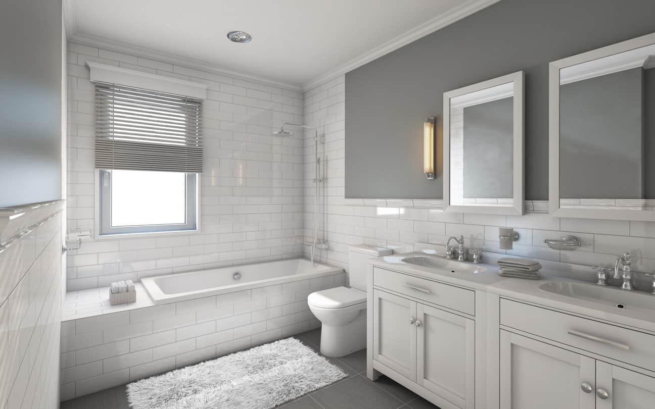Lined with gray colored tiles and walls, this white bricked tile sensation of a primary bath is relaxing but modern. The brushed silver fixtures add a luxurious touch to tie it all together.