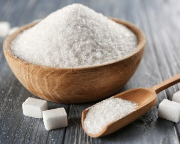 White Sugar in a bowl and spoon