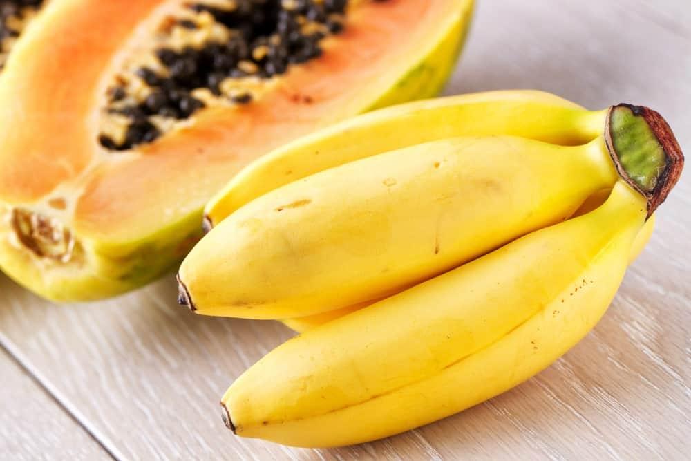 A papaya and a bunch of bananas