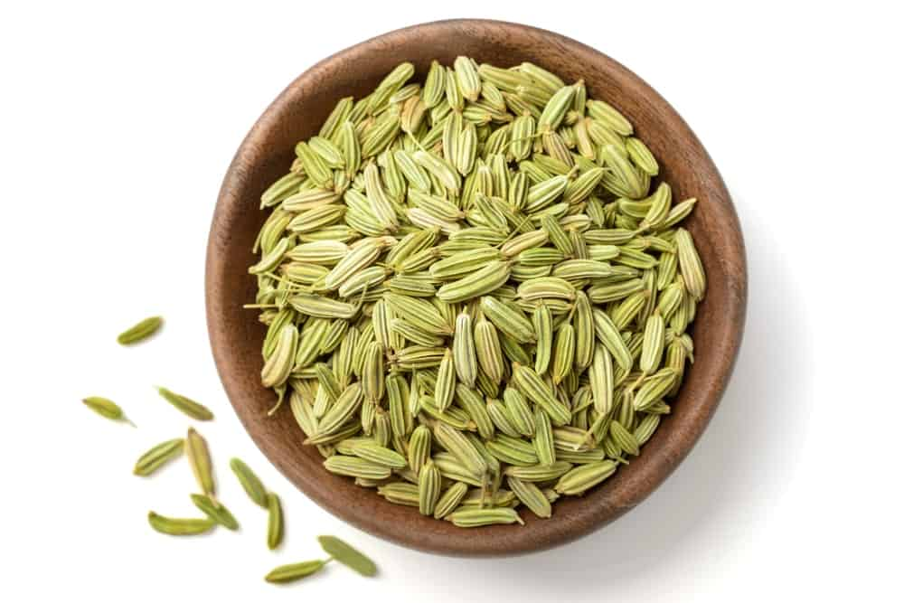 Fennel seeds in a wooden plate