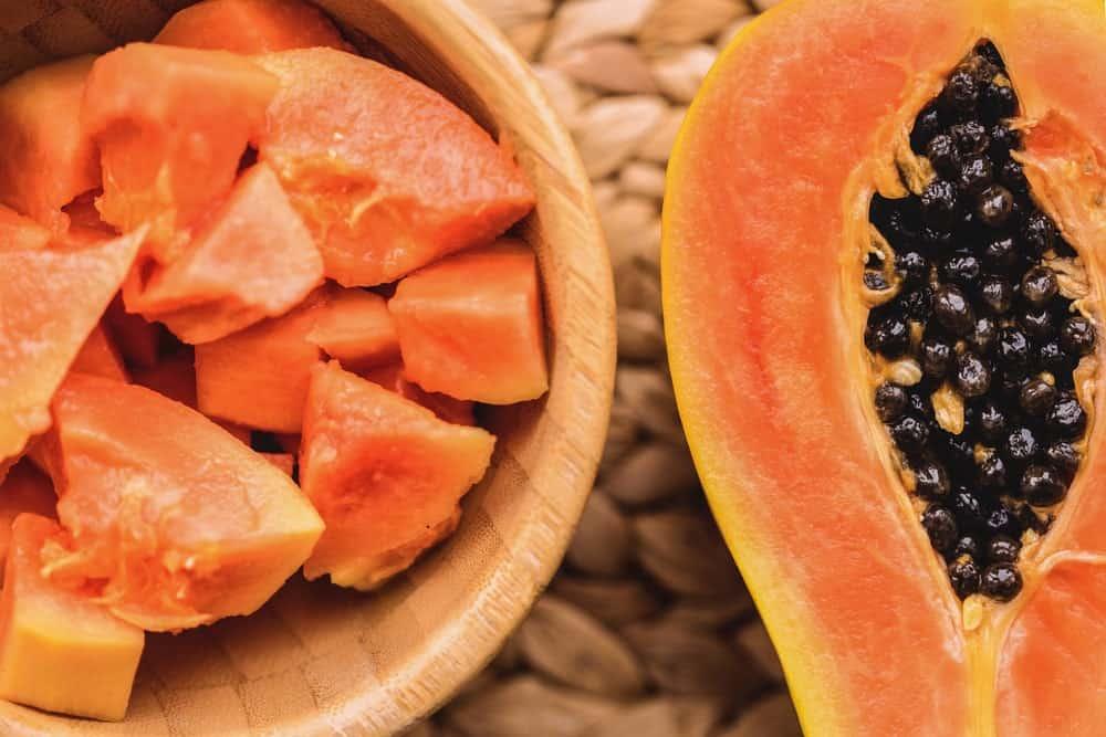 A half slice and cubes of sweet papaya.