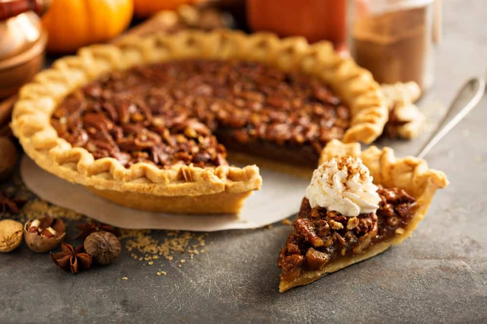 Pecan pie and a slice of it.