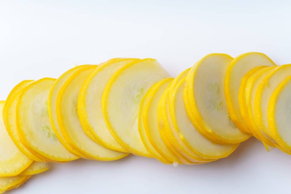 Slices of Yellow Squash on White Background