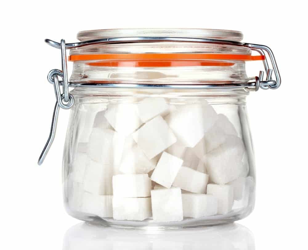 Sugar cubes in a glass container