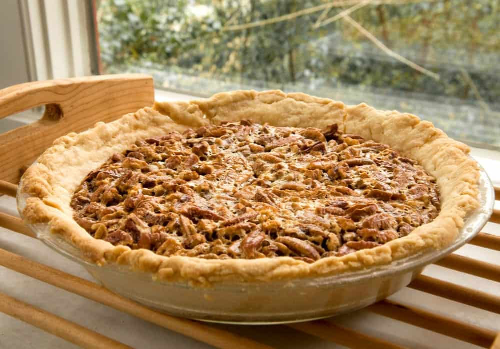 Pecan pie cooling on a rack.