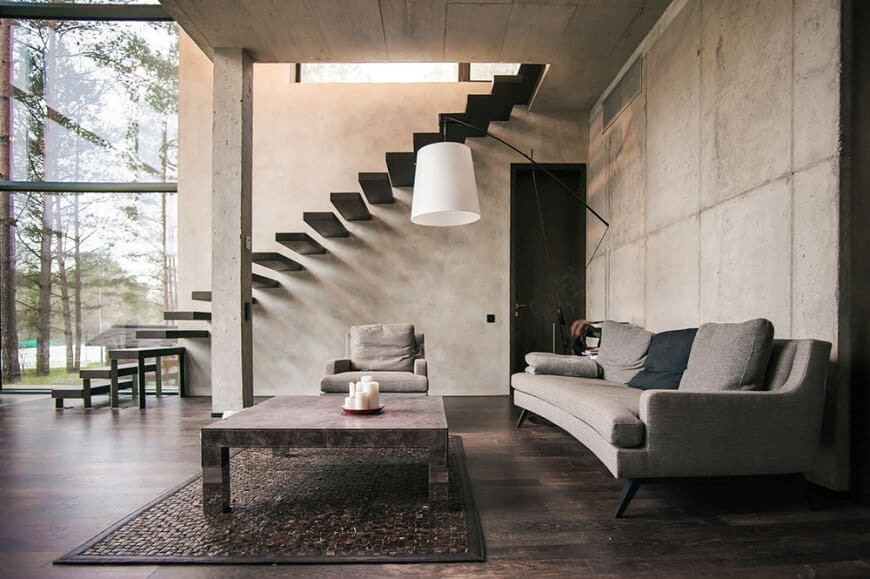 With the floating staircase and mid-century modern sofas, this ultra-cool living room shows us how you can give a modern spin to a standard style. The mix of wooden tiles and lovely gray sofas is a gentle reminder of how these two poles-apart colors can go well together.