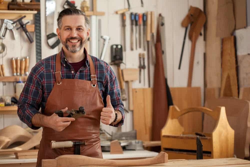 Carpenter working with walnut wood
