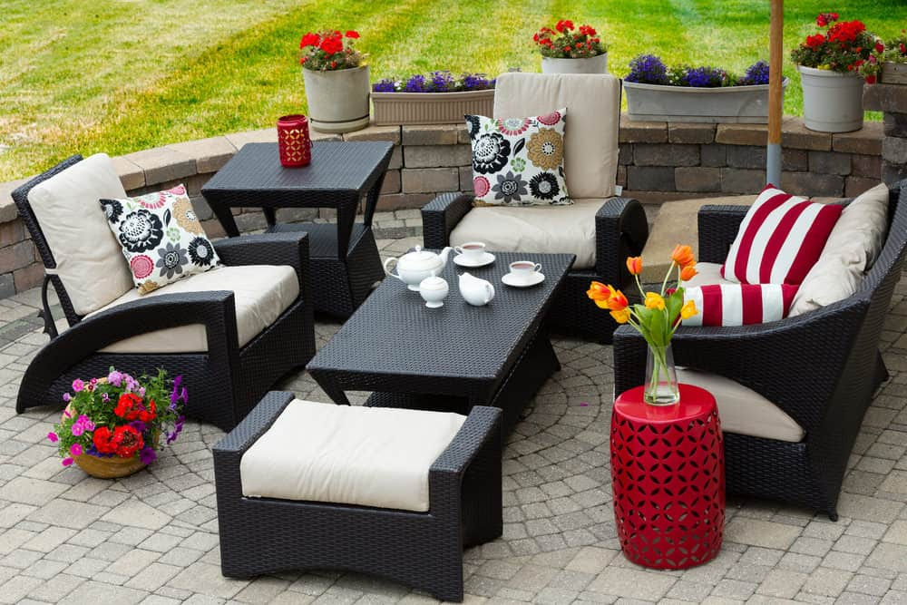 Gray brick patio with dark lounge furniture