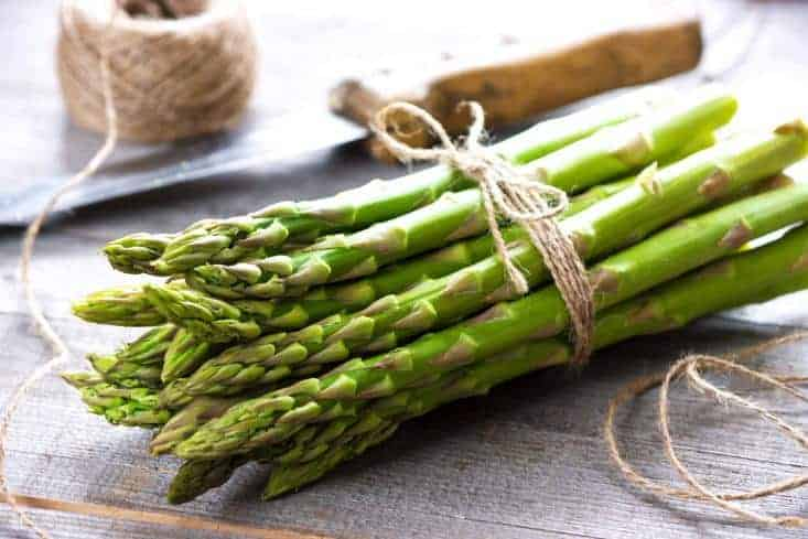 Asparagus bunched up together on table