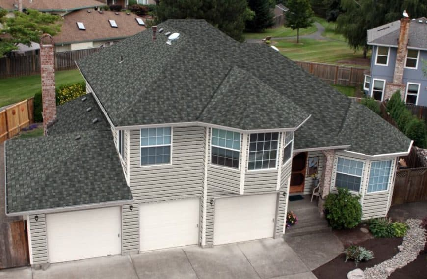 Dark gray asphalt shingles on roof of house