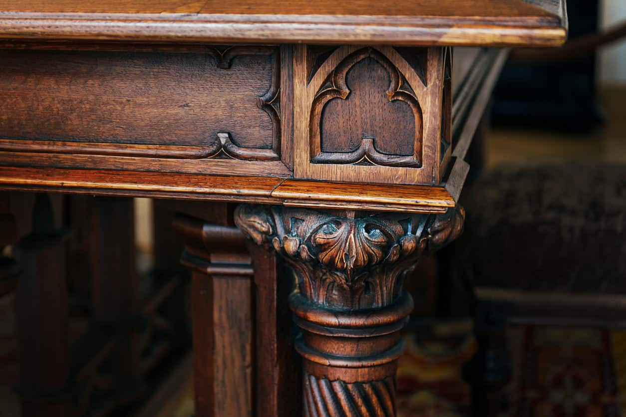 Close-up of engraving details on antique desk