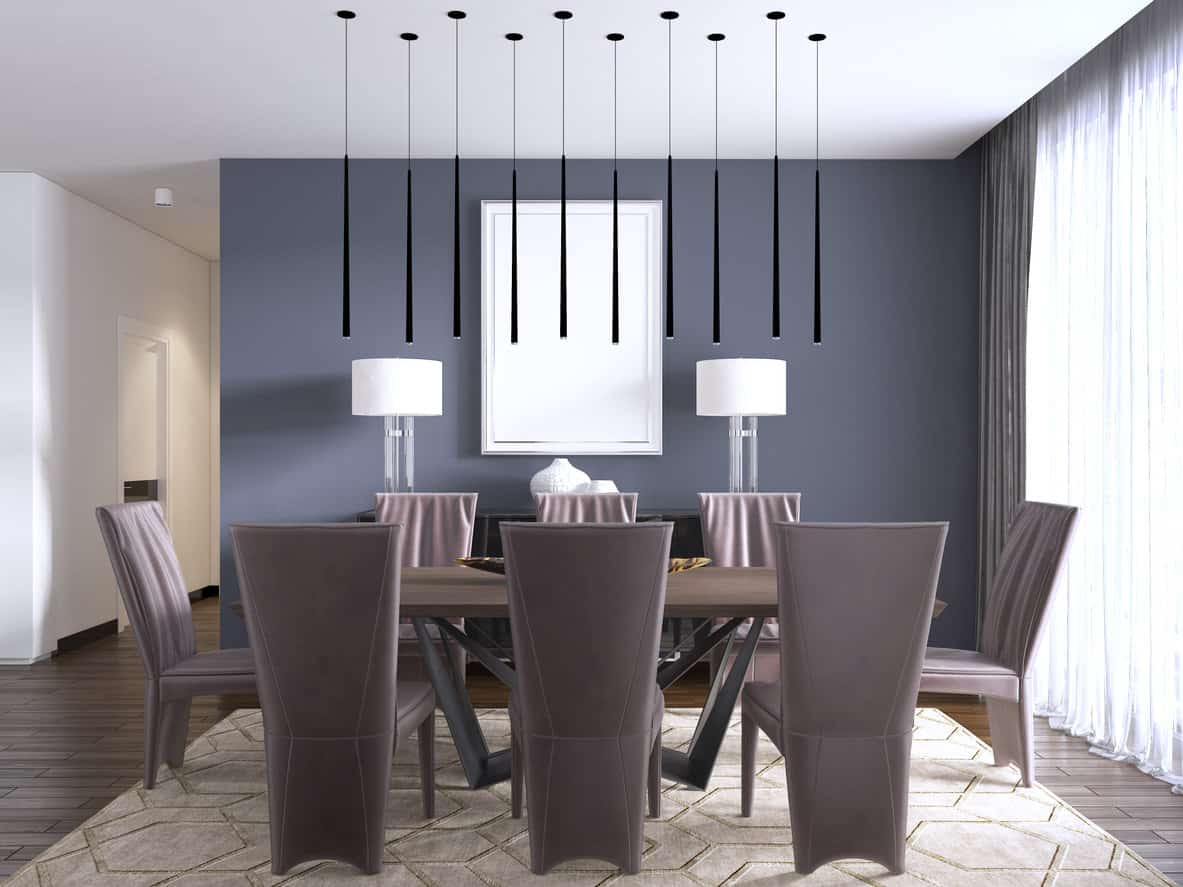 Cool modern dining room with gray-blue accent wall