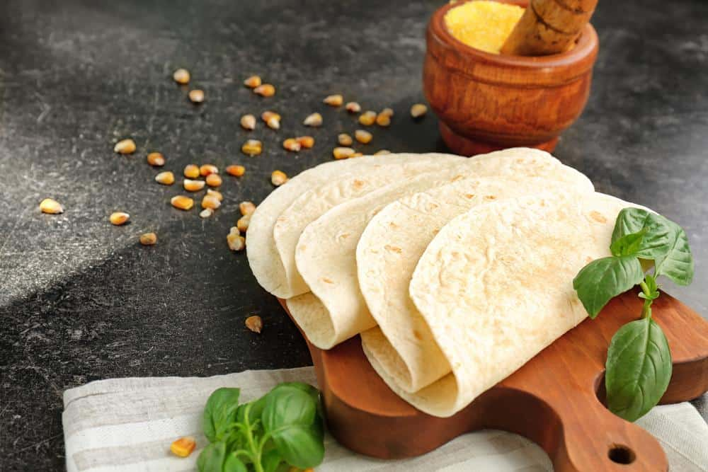 Freshly cooked tortillas on wooden board