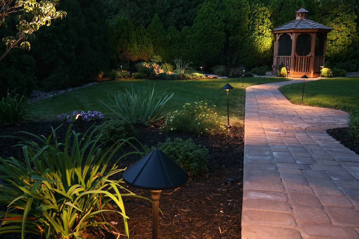 Home with terrific backyard outdoor lighting
