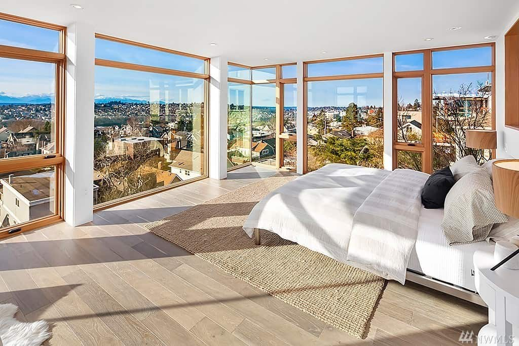 Incredible modern primary bedroom with city views