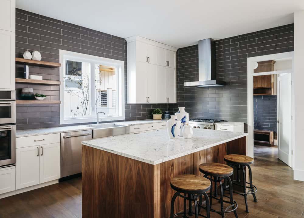 Kitchen with walnut flooring and island