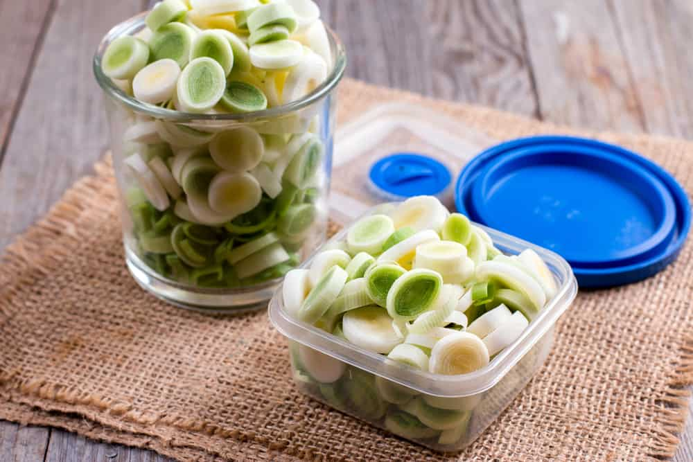 Sliced leeks in a plastic box ready for packing