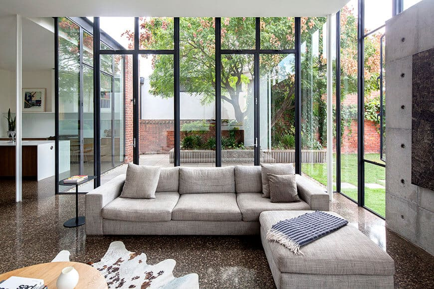 If your living room is next to your pretty garden, now you know how to design it to accentuate its beauty. Large glass windows are the perfect way to have the perfect view of the outside from the inside.