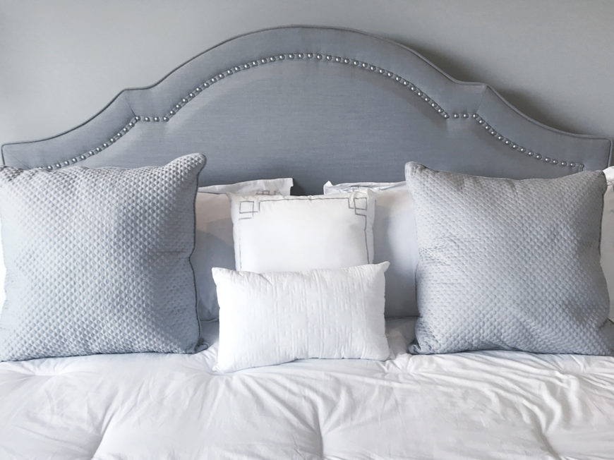 Nicely made up bed with elegant bedding