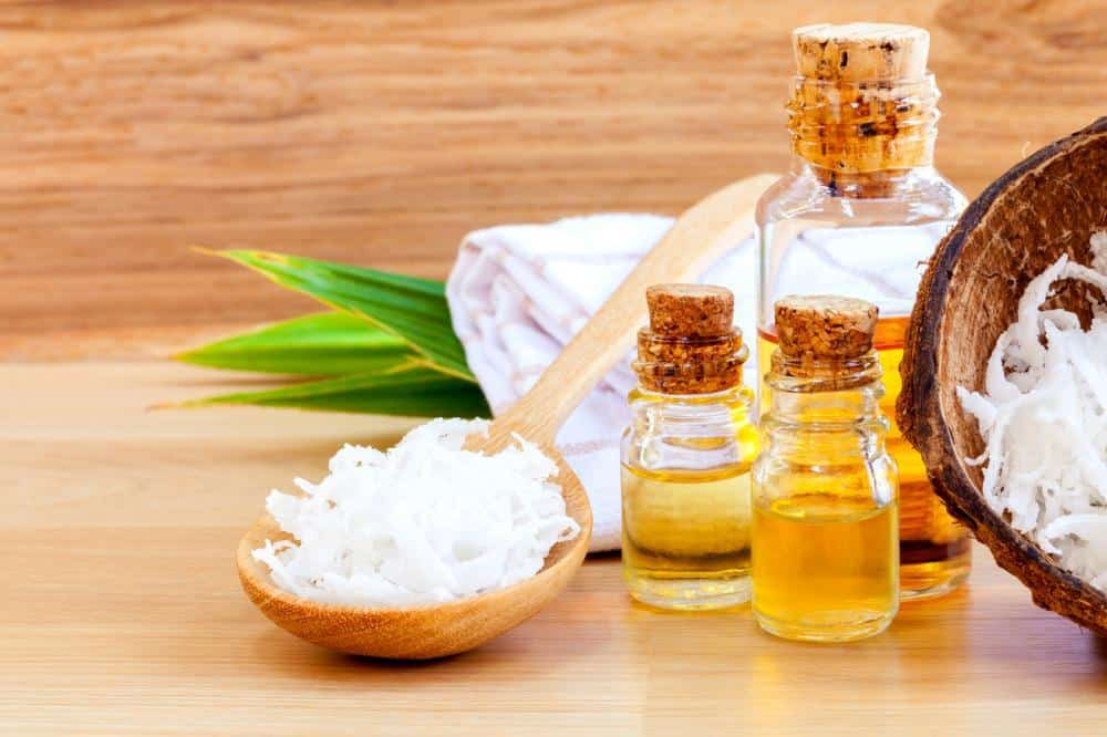 Coconut oil stored in glass bottles