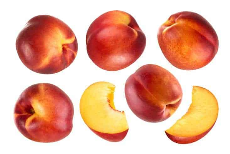 One sliced and five whole nectarines