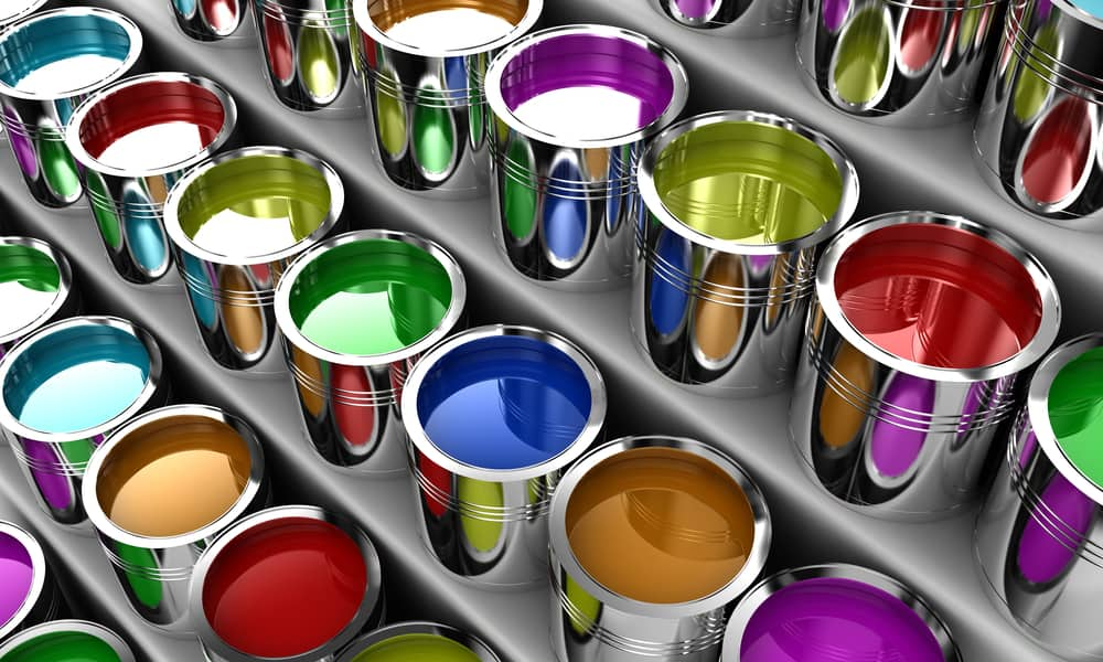 Open boxes of colorful paint on shelves
