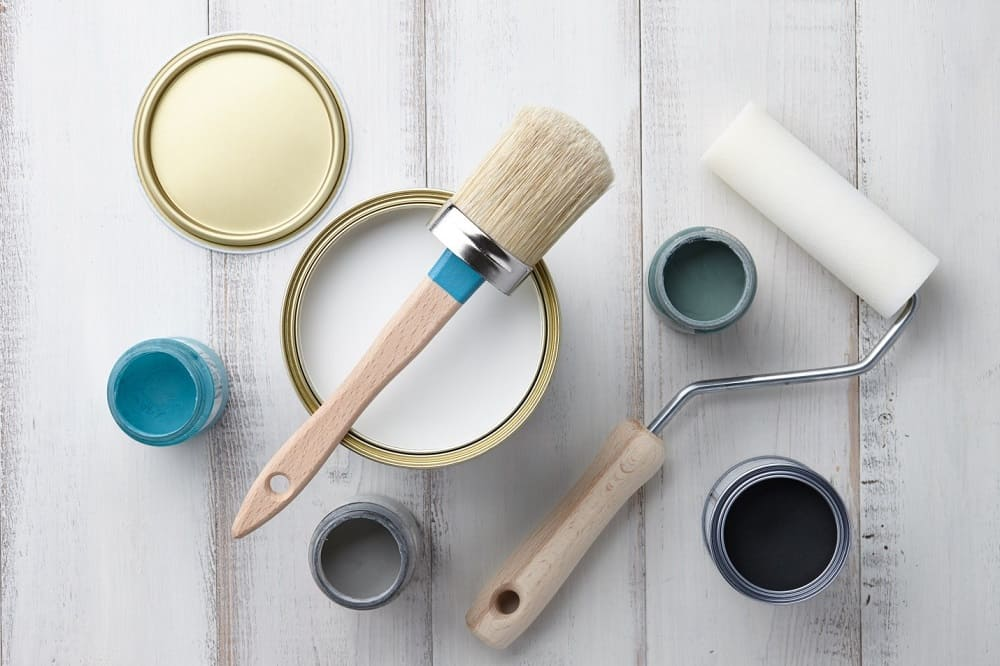 painting supplies on a white table
