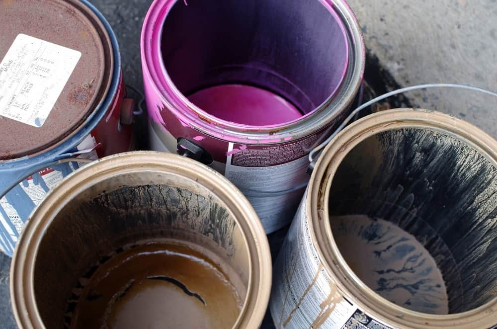 empty paint cans of different colors