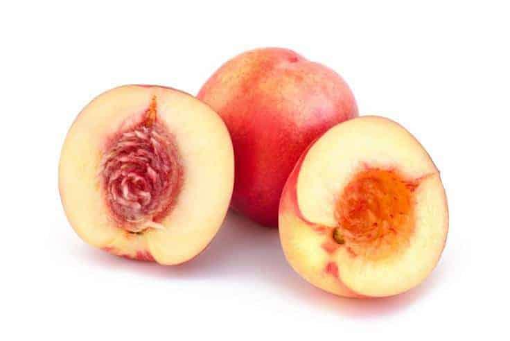 Halved and unhalved nectarine
