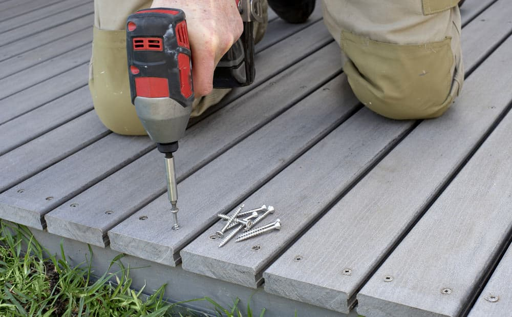 Building a deck with drill and nails.