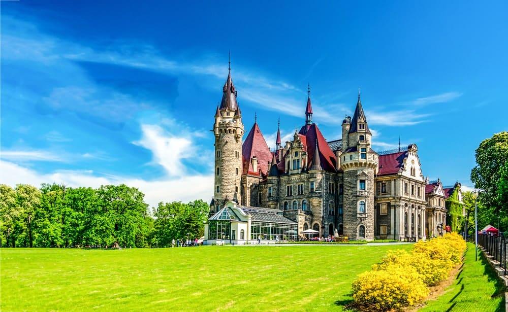 A castle with a lush green garden.