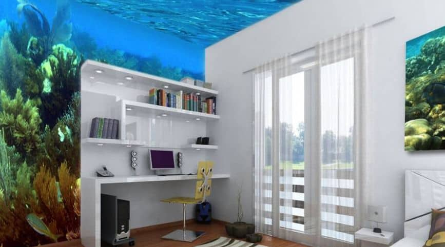 Small white home office with built-in open shelving and desktop and an aquarium-themed ceiling and wall.