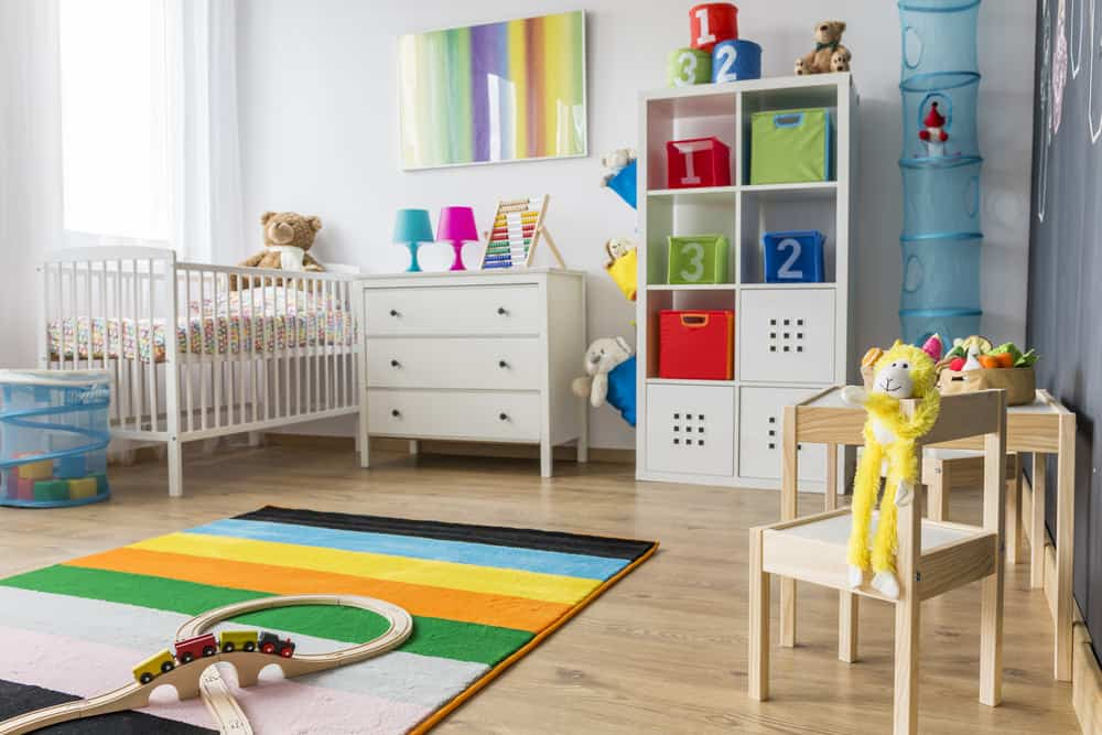 Gender-neutral nursery room with colorful accessories.