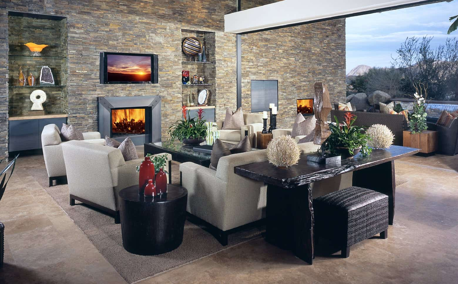 Contemporary living room with stone brick wall and a fireplace.