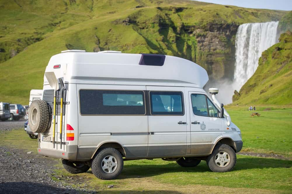 Conversion van parked up near Skogafoss waterfalls in Iceland.
