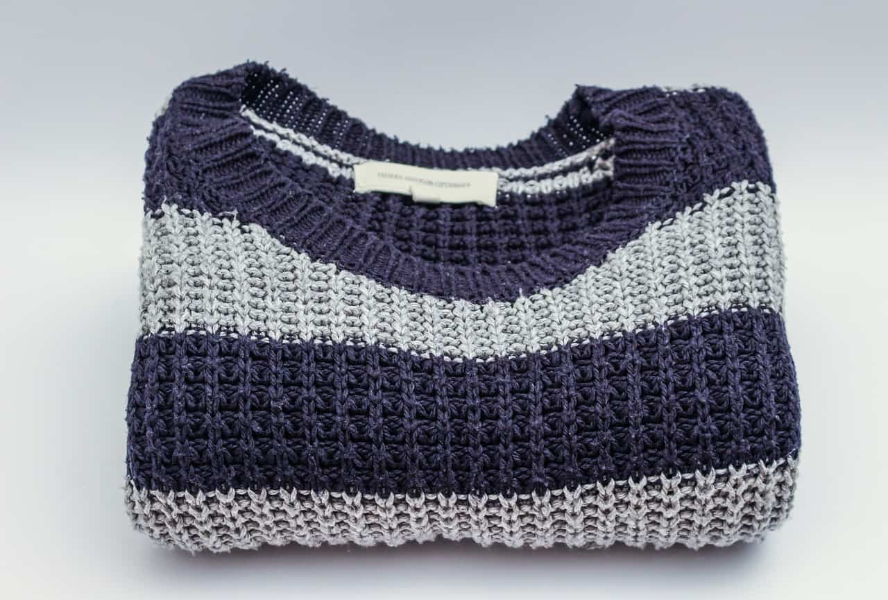 Folded blue and grey sweater