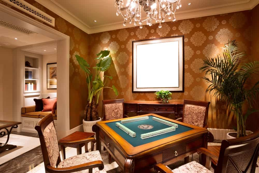 A card or mahjong table in the game room.
