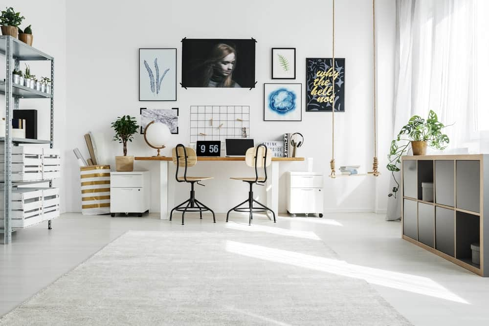 Spacious white home office with different types of storage.