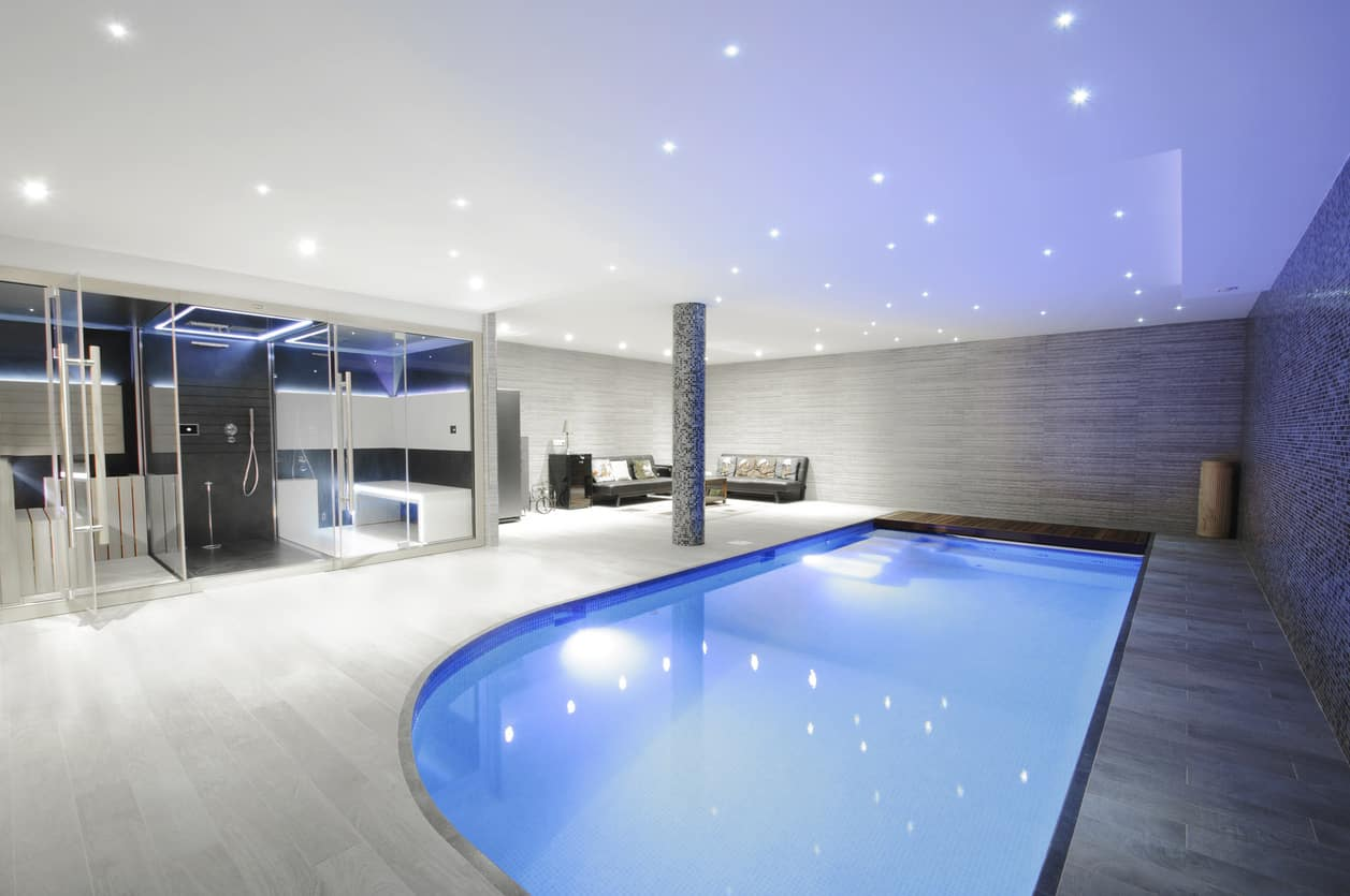 This indoor pool is quite a display of splendor with an angled design, beautiful grey interiors and soft sparkling lights on the ceiling that look like stars in the night.