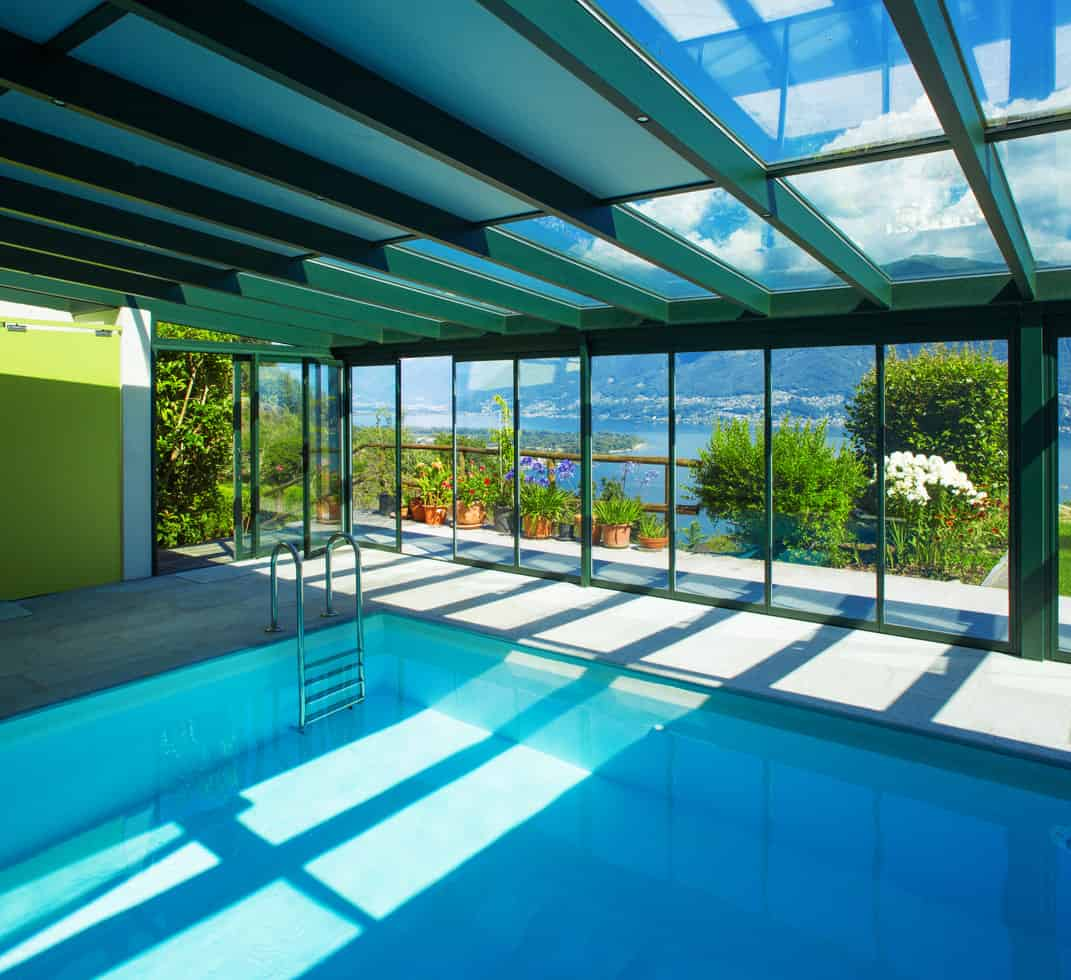 This gorgeous swimming pool is almost like words would fail you. A glass ceiling that lets you travel in a world of your own and huge surrounding glass windows letting you feast your eyes on plush greenery and magnificent flowers, this indoor pool is a dream come true.