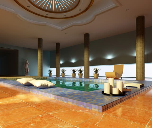 Funky and different, this indoor pool has massive wooden pillars and pretty tiled pool walls giving it a very refined look.