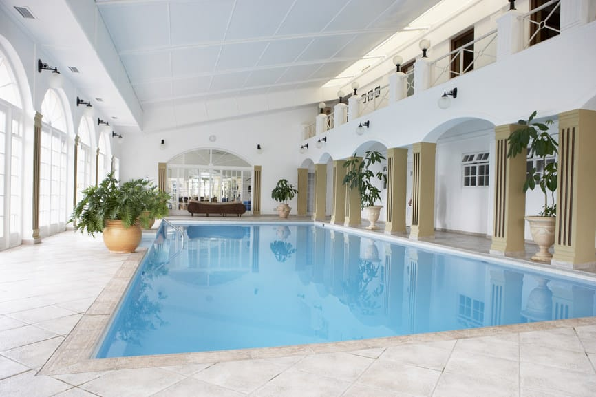 This is an example of a classic swimming pool with stark white tiles, walls and ceiling, which looks simply pretty.