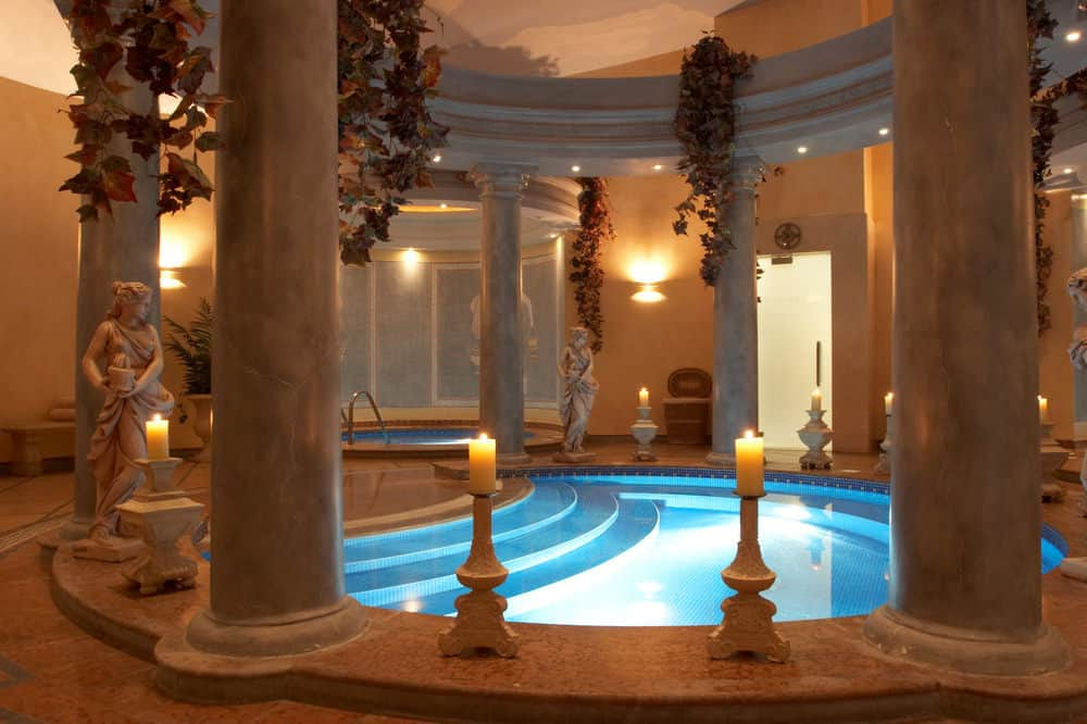 Romantic and exotic is the best way to describe this indoor pool. Surrounded by lit candles, towering pillars and flowers dangling from the ceiling, and sporting soft golden-orange light tones in the entire space, this pool is perfect to surprise a loved one.