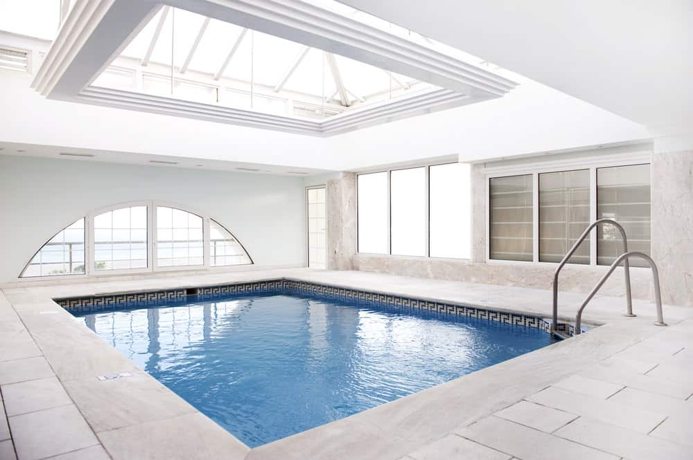 Simply stunning is what this indoor pool really is. The simple ash grey tiles and white textured ceiling makes it look very simple and so pretty.