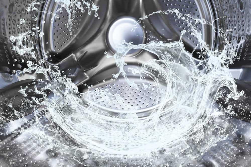 Water spinning inside a washing machine.