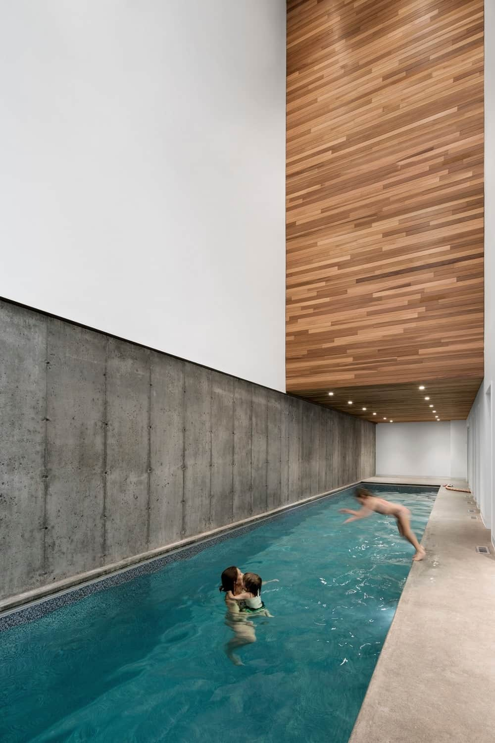 This indoor pool is an excellent option if you have a lot of kids in your house or if you are a true swimmer who loves to take laps in the water. It is quite a large swimming pool that extends from one end of the area to the other with a huge drop-down wooden ceiling full of small, yellow lights.
